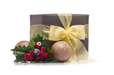 Present decorated with Christmas decoration, over white