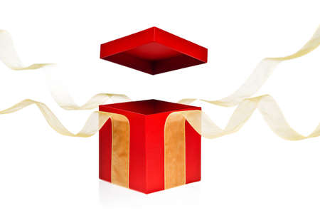 Red Present Box with open cover and yellow flying ribbon photo
