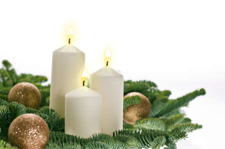 Three candles in advent setting with real Christmas tree branches photo