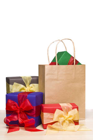 Christmas presents and a shopping bag, over white photo