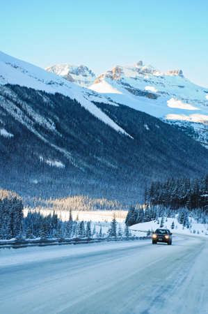 snowy mountain: Highway in Winter through mountains little traffic Stock Photo