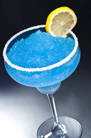 margarita drink: Blue margarita Cocktail in front of different colored backgrounds