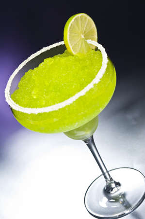 margarita: Classic margarita cocktail in front of different colored backgrounds