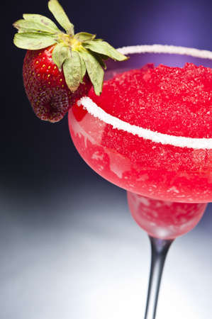 Strawberry margarita Cocktail in front of different colored backgrounds photo
