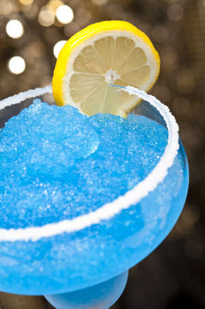 Blue margarita Cocktail in front of different colored backgrounds photo