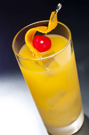 Harvey Wallbanger Cocktail in front of different colored backgrounds Stock Photo - 11484108
