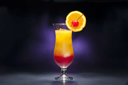grenadine: Tequila sunrise Cocktail in front of different colored backgrounds