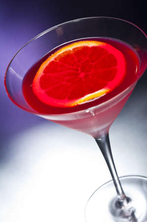sweet vermouth: Negroni cocktail in front of different colored backgrounds Stock Photo