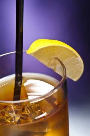 Long Island Iced tea in front of purple background photo