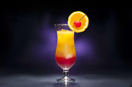 Tequila sunrise Cocktail in front of blue background photo