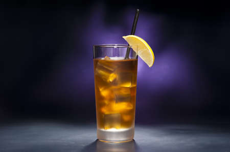 gin: Long Island Iced tea in front of purple background