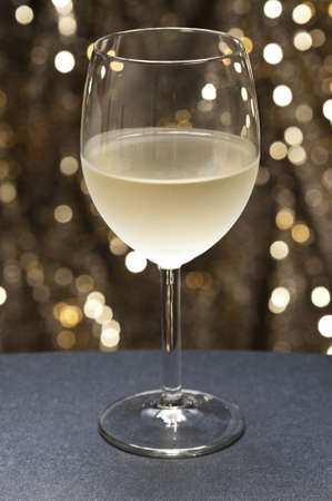 White Wine in front of beautiful gold glitter background Stock Photo - 12233041