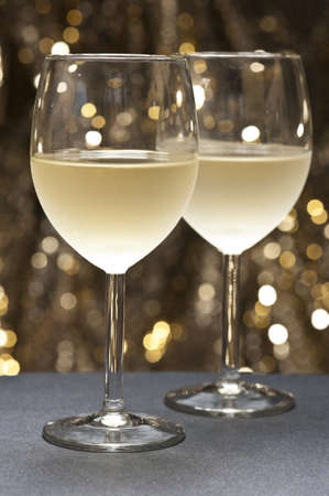 chardonnay: White Wine in front of beautiful gold glitter background  Stock Photo