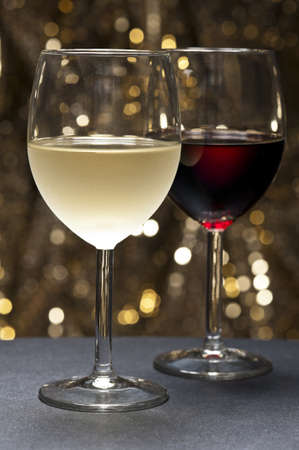 syrah: White and Red Wine in front of beautiful gold glitter background