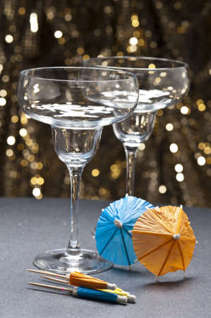 Margarita glass in front of glitter background in front of gold glitter background photo
