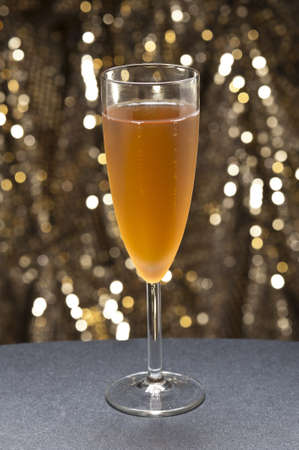 Champaign glass in front of gold glitter background photo