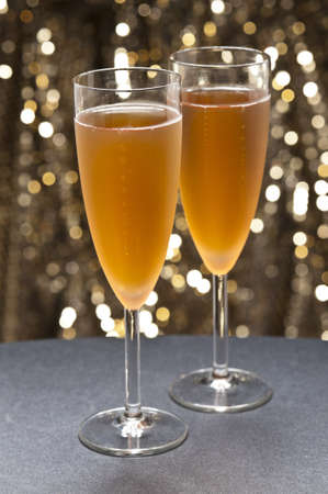 champaign: Champaign glass in front of gold glitter background Stock Photo