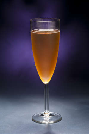 Champaign glass in front of blue purple background Stock Photo - 12233054