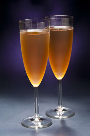 Champaign glass in front of blue purple background photo