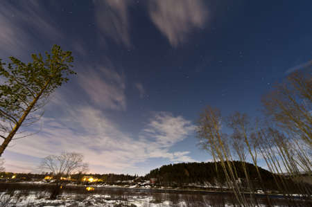 glimpse: Winter scene in Norway, above the Arctic Circle with a glimpse of the northern lightsb
