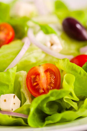 Fresh Greek salad with organic ingredients photo