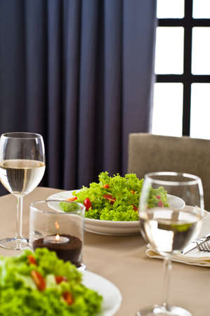 Inside interior table setting with beautiful salad photo