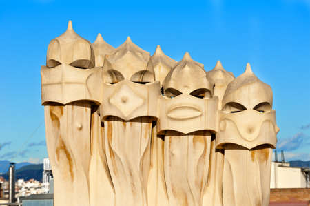 BARCELONA - 2011 December 15  Chimneys covered with ceramic fragments that look like helmets at La Pedrera  Casa Mila  on Dec 15, 2011 in Barcelona, Spain  Casa Mila was built in 1910 by Antoni Gaudi   Stock Photo - 12789465
