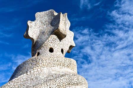 BARCELONA - 2011 December 15  Chimneys covered with ceramic fragments that look like helmets at La Pedrera  Casa Mila  on Dec 15, 2011 in Barcelona, Spain  Casa Mila was built in 1910 by Antoni Gaudi   Stock Photo - 12789471