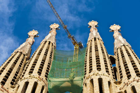 uncomplete: BARCELONA, SPAIN - DECEMBER 15: La Sagrada Familia Exterior - the impressive cathedral designed by Gaudi, which is being build since 19 March 1882 and is not finished yet December 15, 2011. Editorial