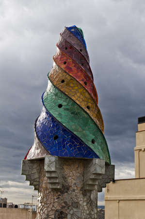 BARCELONA, SPAIN - DECEMBER 15  The mosaic chimneys made of broken ceramic tiles on roof of Palau Guell , one of the earliest Gaudi Stock Photo - 12789479