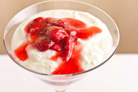 strawberies: layered dessert made from strawberies and yogurt  pudding simple setting