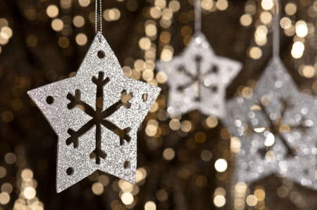 Artificial Snowflake in Silver shining over a golden background Stock Photo - 13814749
