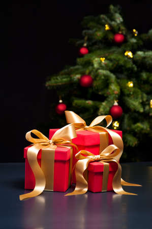 place card: Three presents with gold ribbon in an elegant Christmas setting Stock Photo