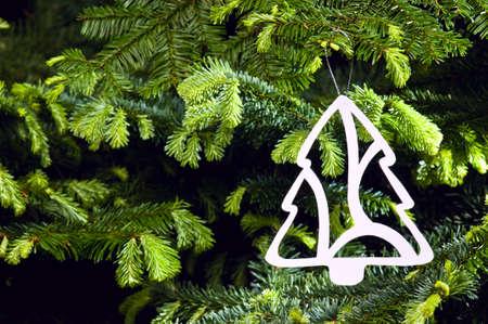 public celebratory event: Tree shape Christmas ornament in fresh green Christmas tree