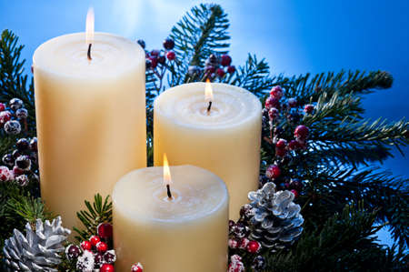 advent candles: Three candles in an advent flower arrangement for advent and Christmas