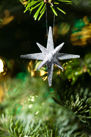 Decorative Silver Star ornament in a Christmas tree  photo