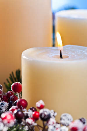 Three burning candles in an advent flower arrangement for advent and Christmas a nice close up shoot Stock Photo - 14265102