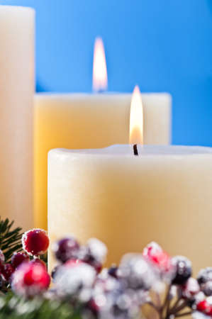 Three burning candles in an advent flower arrangement for advent and Christmas a nice close up shoot Stock Photo - 14265103