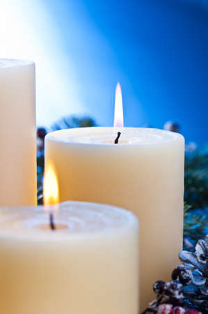 Three burning candles in an advent flower arrangement for advent and Christmas a nice close up shoot Stock Photo - 14265101