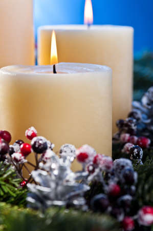 Three burning candles in an advent flower arrangement for advent and Christmas a nice close up shoot Stock Photo - 14265105