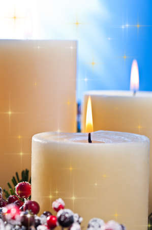 Three candles in an advent flower arrangement for advent and Christmas with golden stars Stock Photo - 14364280