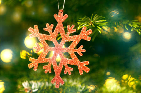 Red snow flake in a christmas tree with neon colors and nice glow Stock Photo - 14364287