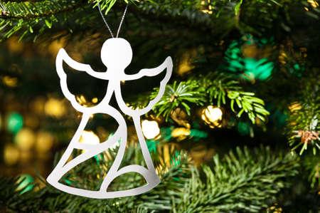 Angel shape Christmas ornament in fresh green Christmas tree Stock Photo - 14463240