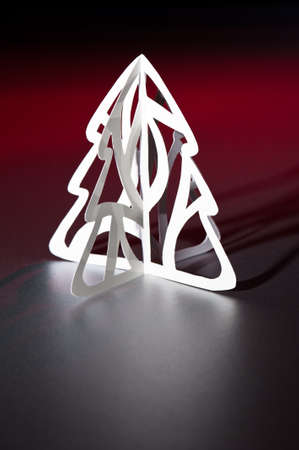 Paper cut Christmas tree in red and white with long shadow photo