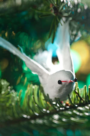 Decorative bird shape ornament in a Christmas tree Stock Photo - 14463226