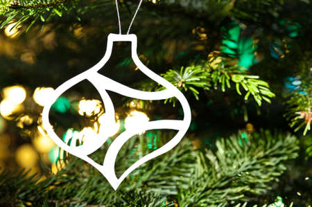 White paper cut bauble shape ornament in real tree Stock Photo - 14539907