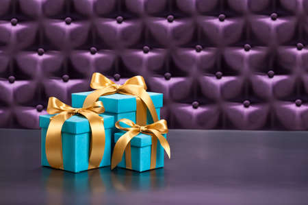 Present in front of a button tufted purple silk background photo