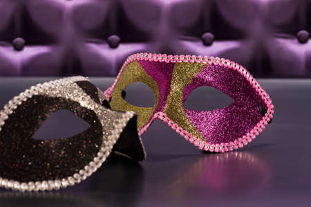 button tufted: Elegant mask for Masquerade in front of a button tufted purple silk background