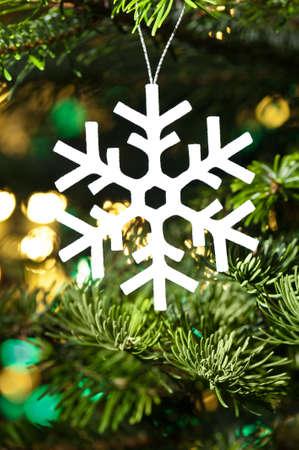 White artificial snowflake in Christmas tree Stock Photo - 14800927