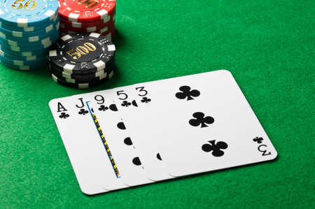 casino table: Poker flush game with chips on a Casino table Stock Photo